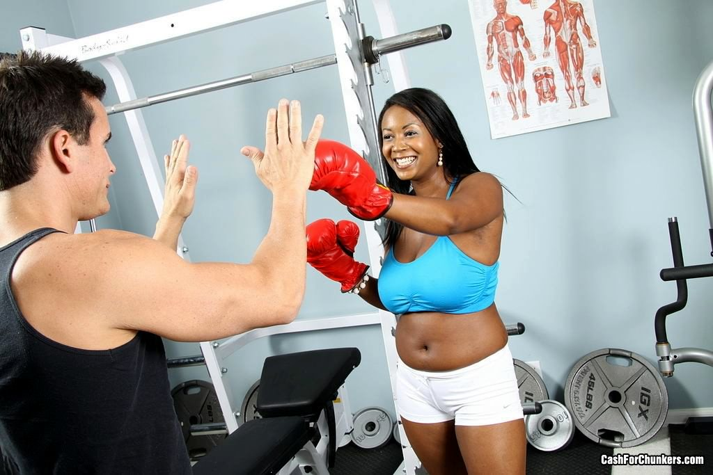 A black sporty woman doing it in the gym from GK